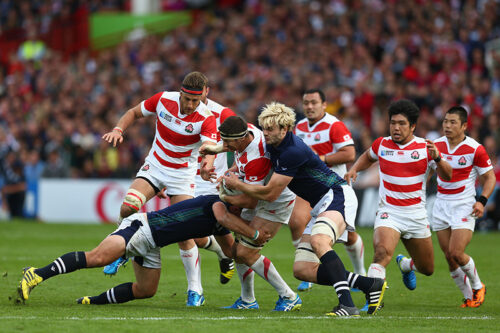 GLOUCESTER, ENGLAND - SEPTEMBER 23:  Richie Gray (R) of Scotland tackles Luke Thompson of Japan during the 2015 Rugby World Cup Pool B match between Scotland and Japan at Kingsholm Stadium on September 23, 2015 in Gloucester, United Kingdom.  (Photo by Steve Bardens - World Rugby/World Rugby via Getty Images)
